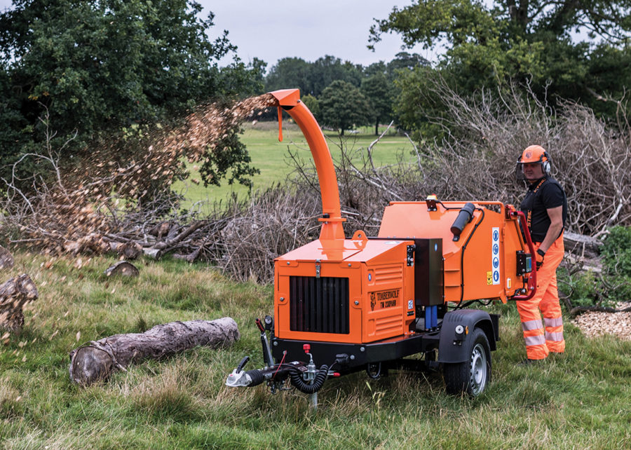 Timberwolf TW 230PAHB Petrol Road Tow Wood Chipper - feeding brash